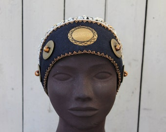 Hand-made hat.Unique creation - Navy Blue and Black Hat adorned with metal pallets then embroidered with beads and pearls