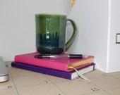 Avocado green mug with brushed detail