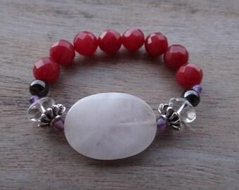 An agate bracelet with Amethyst, hematite, quartz crystal, antiqued silver and Rose Quartz