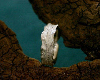 narrow silver ring in shape of a fern leaf