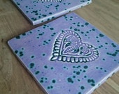 Pair of Indian heart imprint ceramic Coasters