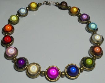 Miracle bead necklace with bronze frames