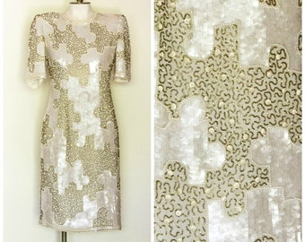 Showstopping white and gold sequined and beaded sheath dress by Judith Ann Creations