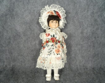 Vintage Doll with Floral Clothing