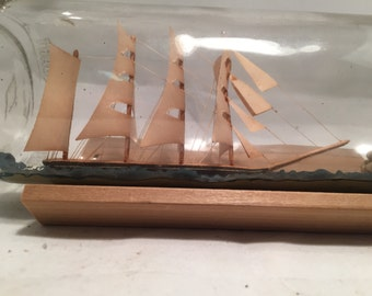 4 masted hand made ship in a bottle nautical decoration