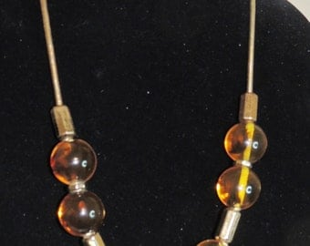 Incredible transparent Amber vintage large balls on rope necklace hang tag marked Liz Clairborne 1976 large gold spacers beads LC Ori