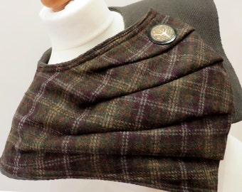 A totally unique, Outlander Inspired capelet created in a pure wool tartan. Fabric manipulation techniques. Hand made in the UK
