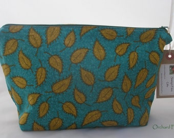 Zipped make-up/wash bag (larger size) -deep blue with green leaves fabric