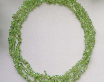 Long Free form Peridot chip necklace with sterling silver clasp.