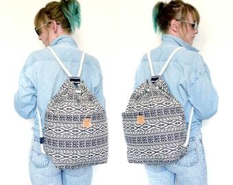 Aztec print black & white bucket backpack.