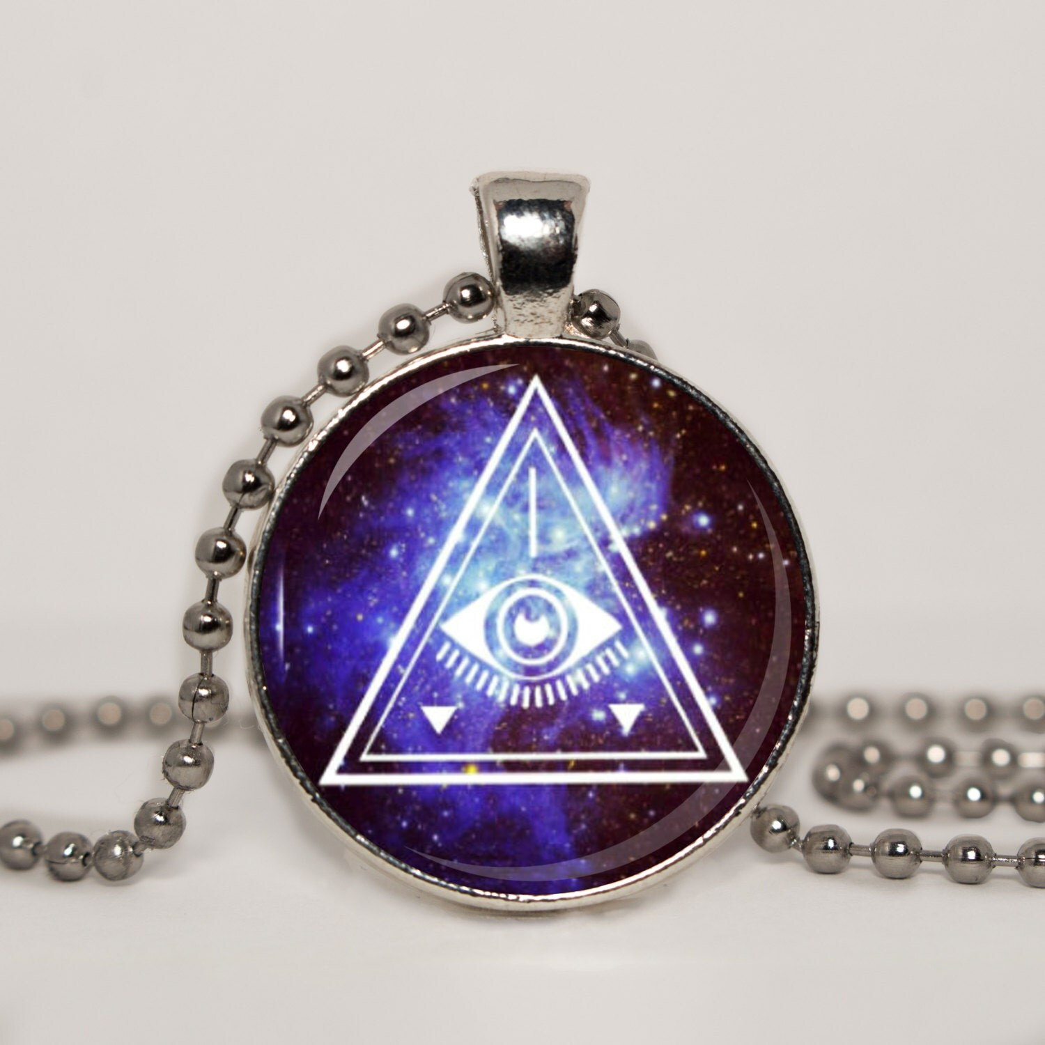 illuminati pendant necklace by starlingdesigns7 on etsy