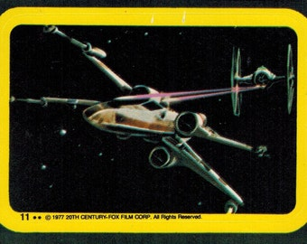 1977 OPC O-Pee-Chee Star Wars Series 1 (Blue) Non Sport Trading Card Sticker Insert : #11 X-Wing Tie-Fighter