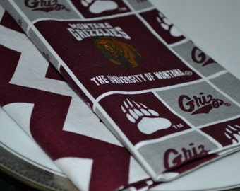 Set of 8 reversible cloth napkins featuring the University of Montana Grizzlies and Cevron Stripes.