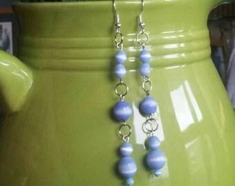 Blue with white swirls dangle earrings