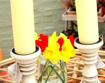 Pair of shabby chic candlesticks with cream candles