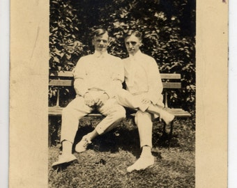 Vintage Photo of Two Men Sitting on a Bench