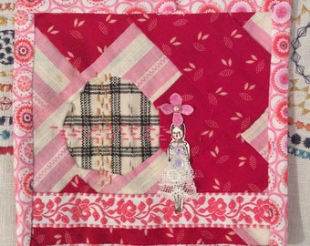 Paperdoll series on patchwork square with reverse applique