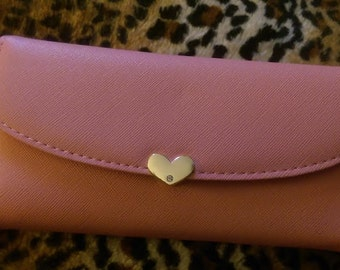 Super cute Pink on pink wallet with a heart shaped ID window