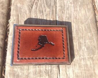 Hand stitched, leather inlay, Alaska belt buckle
