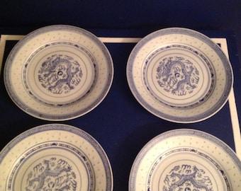 Four Blue and White Dragon Rice Design Plates