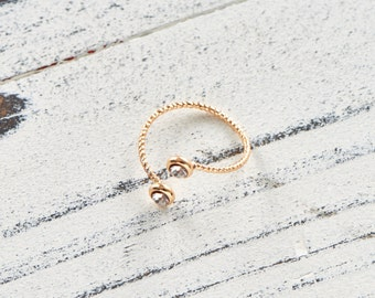 Gold filled delicate ring wraps around your finger