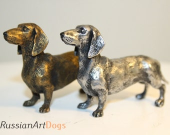 Miniature dachshund dog figurine from the alloy of tin pewter statuette