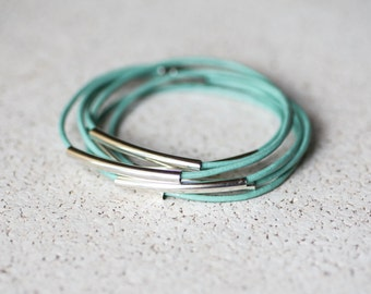 Turquoise leather bracelet with silver tubes.