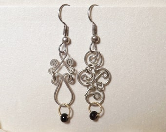 Silver asymmetrical earrings