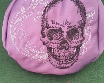 L209.  Coin purse.  Baroque skull design