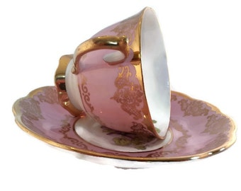 "Vintage Royal Albert ""violet"" pattern footed tea cup with a pink/lavender background with heavy gold accents"