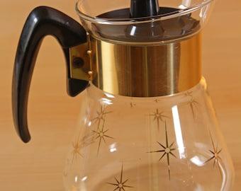 Vintage corning atomic starburst pattern coffee or tea carafe