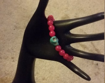 Hot Pink Beaded Bracelet with SkyBlue Skull