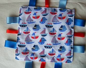 Little Boats square baby Minky Taggy blanket, lovey or comforter in a polyester cotton fabric.