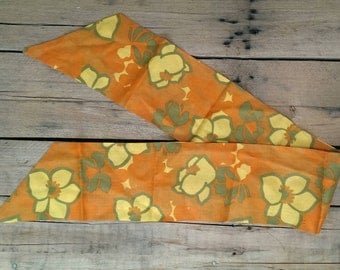 Vintage 1960s scarf / cravat with orange and yellow flower power design