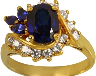Large Oval Shape Sapphire Blue Gem And CZ's Ladies Ring In Heavy Gold Plated 14k