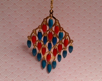 Gilded(Bronzed) blue necklace and coral in enamelled pearls
