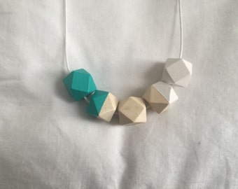 Geometric wooden bead necklace // turquiose and white // hand painted
