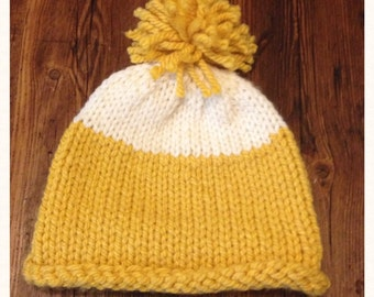 Yellow knitted hat.