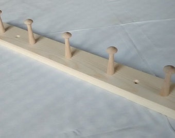 Handmade wooden coat rack with 4 or 5 shaker pegs.