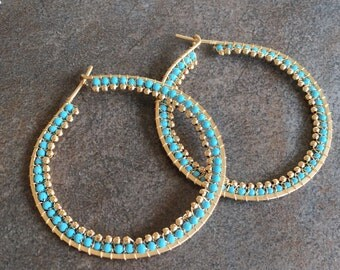 Turquoise and gold large  wire wrapped statement hoops.