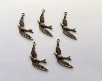 5 Antique Bronze tone Swallow Charms