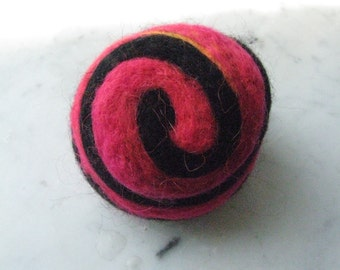 One multi-colored felted pin-cushion, Red and Black