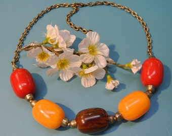 Unique one-of-a-kind adjustable tested vintage 1940s bakelite bead +antiqued brasscolor chain necklace with 5 large red/ yellow/ brown beads