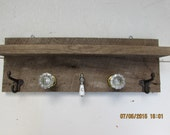 Barnwood Coat Rack made with antique knobs, hooks and faucet handle
