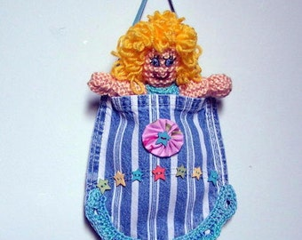 Hand knit Southern Belle doll in a recycled denim pocket