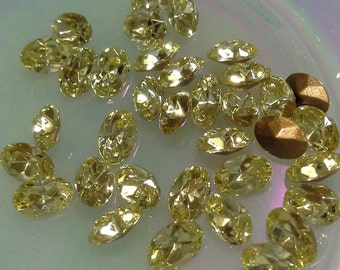 24 Jonquil 6x4mm Ovals Vintage Swarovski Jonquil Ovals With Gold Foiling