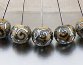 Lampwork headpins - Helix rounds in dark ivory and silver. Lampwork by Jennie Yip