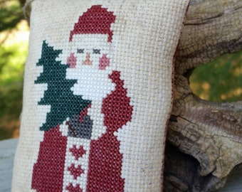 Old Fashioned Santa Holding a Tree Completed Cross Stitch Christmas Ornament