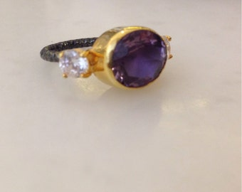 Amethyst two color ring with zirconium stones