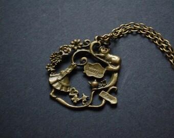 alice in wonderland garden scen necklace